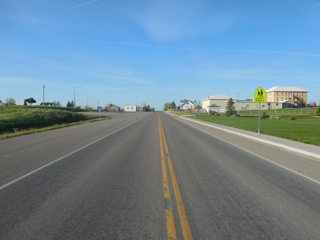 Looking south down the only paved street.  Actually the highway